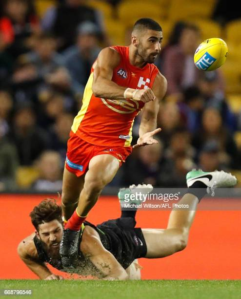 Adam Saad of the Sunsis tackled by Levi Casboult of the Blues during the 2017 AFL round 04 match between the Carlton Blues and the Gold Coast Suns at...