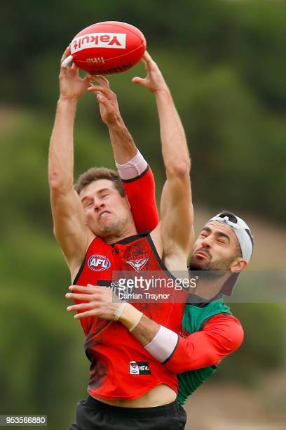 Adam Saad spoils Jackson Merrett during an Essendon Bombers Training Session on May 2 2018 in Melbourne Australia