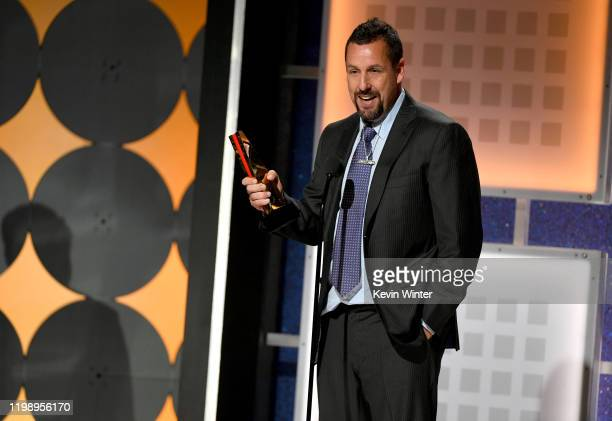 Adam Sandler accepts Best Actor for 'Uncut Gems' onstage during AARP The Magazine's 19th Annual Movies For Grownups Awards at Beverly Wilshire A Four...