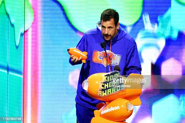 Adam Sandler accepts the Favorite Male Voice from an Animated Movie award for 'Hotel Transylvania 3 Summer Vacation' onstage at Nickelodeon's 2019...