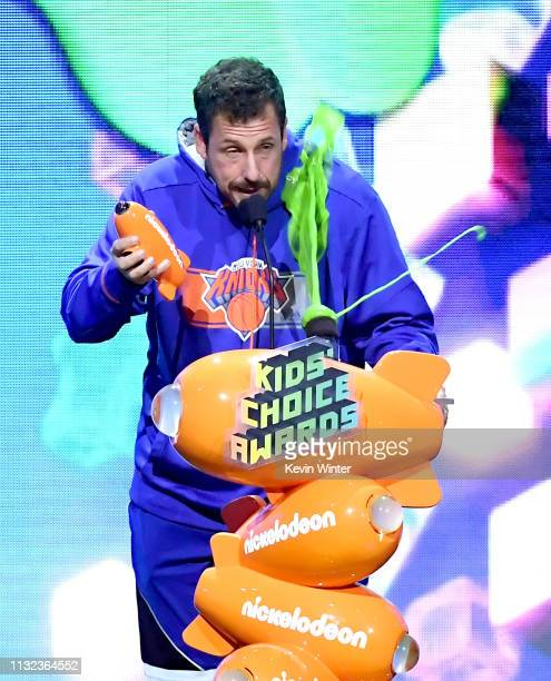 Adam Sandler accpets award onstage at Nickelodeon's 2019 Kids' Choice Awards at Galen Center on March 23 2019 in Los Angeles California