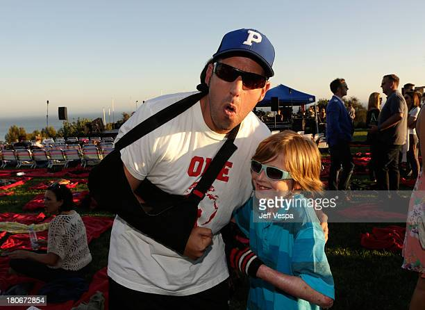 Adam Sandler and Brandon Joseph attend Eddie Vedder and Zach Galifianakis Rock Malibu Fundraiser for EBMRF and Heal EB on September 15 2013 in Malibu...