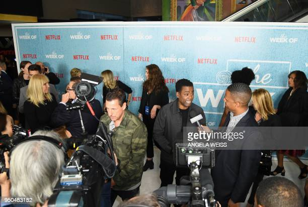 Adam Sandler and Chris Rock are interviewed at the World Premiere of the Netflix film 'The Week Of' at AMC Loews Lincoln Square 13 on April 23 2018...