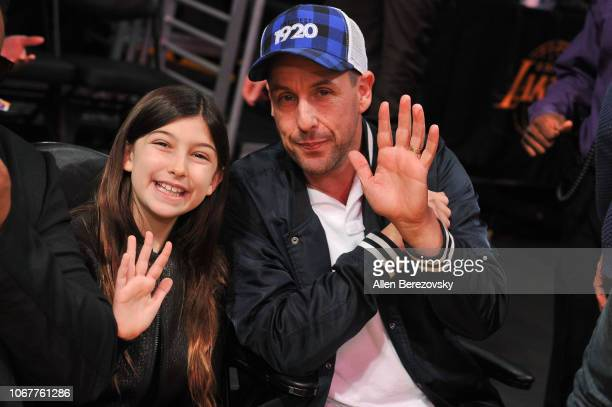 Adam Sandler and daughter Sunny Madeline Sandler attend a basketball game between the Los Angeles Lakers and the Portland Trail Blazers at Staples...