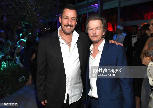Adam Sandler and David Spade attend the 2020 Vanity Fair Oscar Party hosted by Radhika Jones at Wallis Annenberg Center for the Performing Arts on...