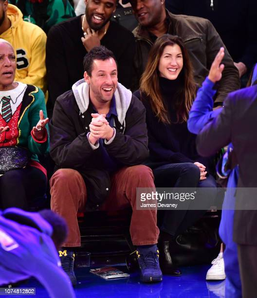 Adam Sandler and Jackie Sandler attend Milwaukee Bucks v New York Knicks game at Madison Square Garden on December 25 2018 in New York City