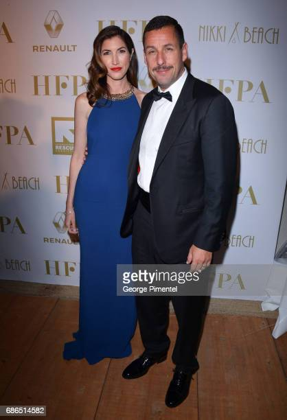 Adam Sandler and Jackie Sandler attend the Hollywood Foreign Press Association's 2017 Cannes Film Festival Event in honour of the International...