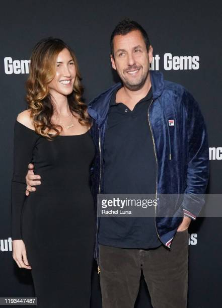 Adam Sandler and Jackie Sandler attend the premiere of A24's Uncut Gems at The Dome at Arclight Hollywood on December 11 2019 in Hollywood California
