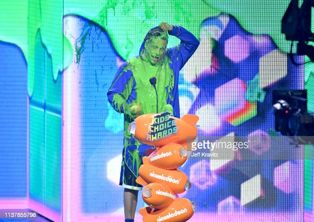 Adam Sandler gets slimed onstage at Nickelodeon's 2019 Kids' Choice Awards at Galen Center on March 23 2019 in Los Angeles California