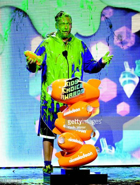 Adam Sandler gets slimed with the Favorite Male Voice from an Animated Movie award for 'Hotel Transylvania 3 Summer Vacation' onstage at...