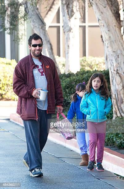 Adam Sandler is seen taking his daughters Sadie Sandler and Sunny Sandler to dance class on December 08 2013 in Los Angeles California