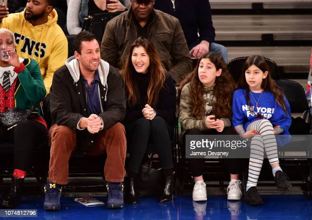 Adam Sandler Jackie Sandler Sadie Sandler and Sunny Sandler attend Milwaukee Bucks v New York Knicks game at Madison Square Garden on December 25...