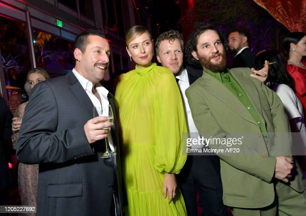 Adam Sandler Maria Sharapova Sebastian BearMcClard and Josh Safdie attend the 2020 Vanity Fair Oscar Party hosted by Radhika Jones at Wallis...