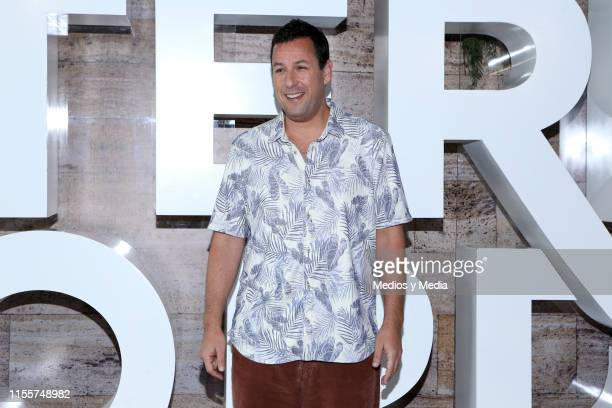 Adam Sandler poses for photos during a press conference to present the film 'Murder Mystery at St Regis Hotel on June 13 2019 in Mexico City Mexico