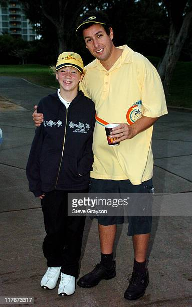 Adam Sandler poses with a Kelsea Bauman prior to teeing off in the Pro Am.