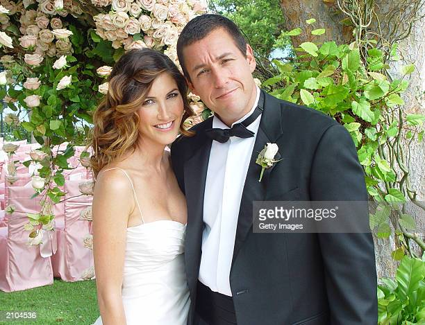 Adam Sandler poses with his bride modelactress Jackie Titone at their wedding June 22 2003 in Malibu California