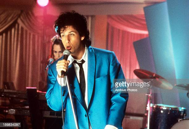 Adam Sandler sings in a scene from the film 'The Wedding Singer' 1998