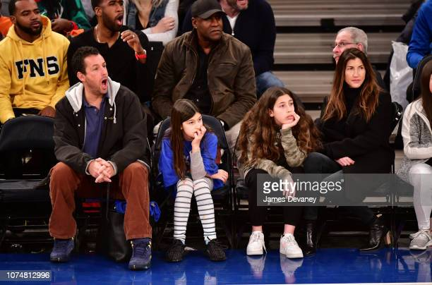 Adam Sandler Sunny Sandler Sadie Sandler and Jackie Sandler attend the Milwaukee Bucks v New York Knicks game at Madison Square Garden on December 25...