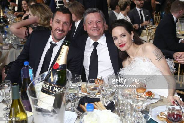 Adam Sandler Ted Sarandos and Angelina Jolie attend the 23rd Annual Critics' Choice Awards on January 11 2018 in Santa Monica California
