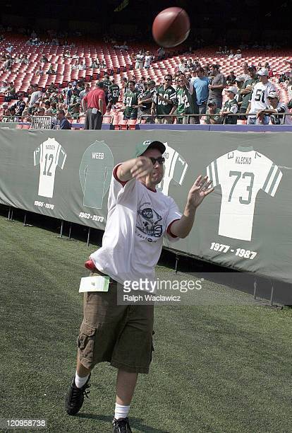 Adam Sandler throws a pass prior to the New York Jets 24 to 17 loss to the New England Patriots on September 17 2006 at Giants Stadium in East...