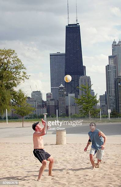 Adam Savick and Jim Carson compete in a game of two-on-two volleyball at North Avenue Beach May 27, 2005 in Chicago, Illinois. Chicago opened its...
