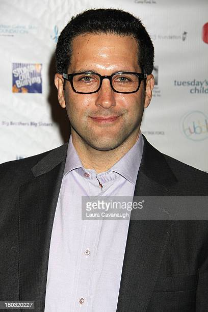 Adam Schefter attends Cantor Fitzgerald And BGC Partners Annual Charity Day at Cantor Fitzgerald on September 11 2013 in New York City