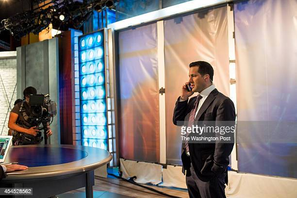 Adam Schefter who has been an NFL Insider at ESPN for five years checks his phone after doing a segment for NFL Live at ESPN Headquarters in Bristol...
