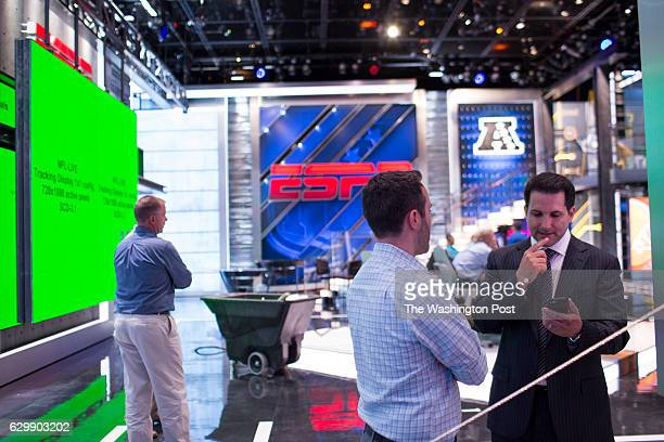 Adam Schefter who has been an NFL Insider at ESPN for five years checks his cell phone in the new NFL studio during a dress rehearsal at ESPN...