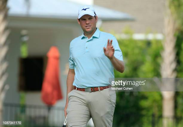 Adam Schenk acknowledges the gallery after making a birdie on the eighth green during the second round of the Webcom Tour Championship held at...