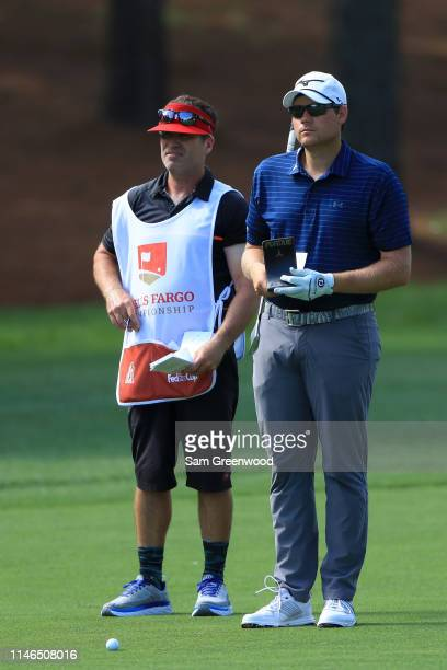 Adam Schenk and his caddie look on from the second fairway during the first round of the 2019 Wells Fargo Championship at Quail Hollow Club on May 02...