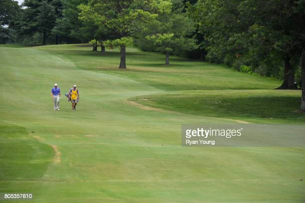 Adam Schenk and his caddy walk up the third fairway during the third round of the Webcom Tour Nashville Golf Open Benefitting the Snedeker Foundation...