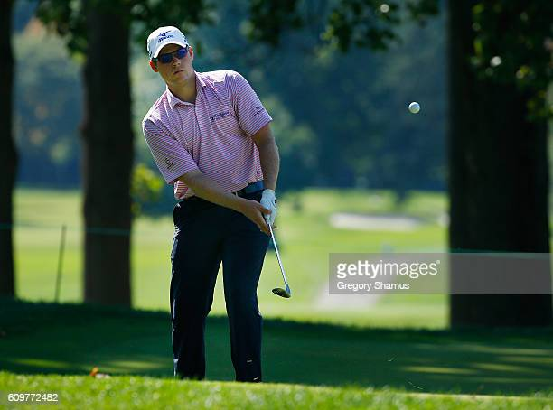 Adam Schenk chips to the fifth green during the first round of the Webcom Tour Nationwide Children's Hospital Championship at The Ohio State...