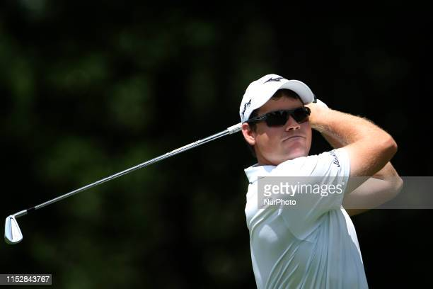 Adam Schenk of Vincennes Indiana hits from the 11th tee during round three of the inaugural Rocket Mortgage Classic at the Detroit Country Club on...