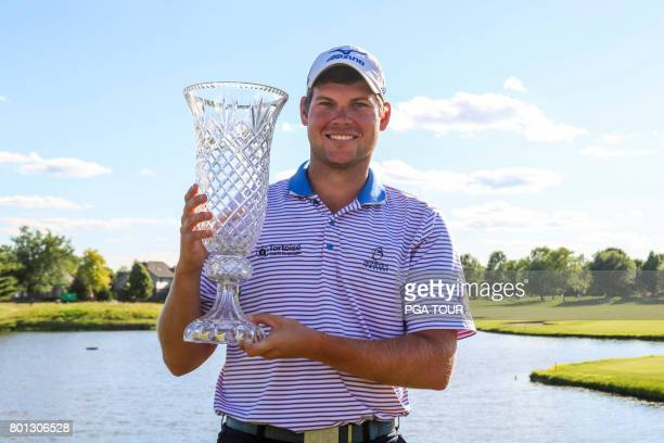 Adam Schenk poses with the winner's trophy after the final round of the Webcom Tour Lincoln Land Charity Championship at Panther Creek Country Club...