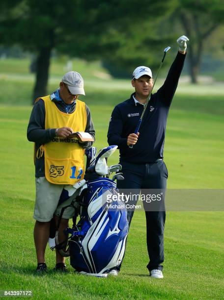 Adam Schenk pulls a club from his golf bag during the first round of the Nationwide Children's Hospital Championship held at The Ohio State...