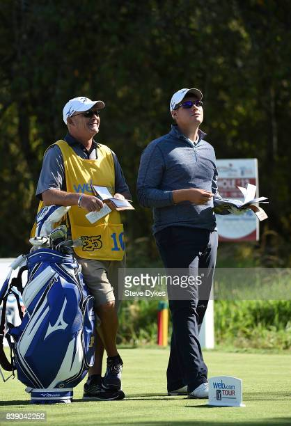 Adam Schenk waits with his caddie on the 12th hole during round two of the WinCo Foods Portland Open at Pumpkin Ridge Golf Club Witch Hollow on...