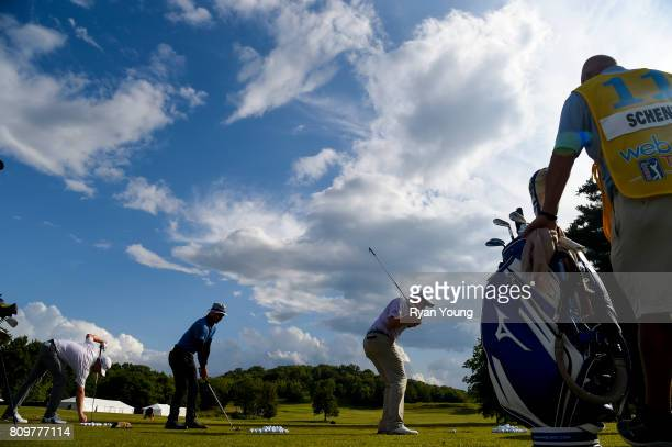 Adam Schenk warms up on the range following a rain delay during the final round of the Webcom Tour Nashville Golf Open Benefitting the Snedeker...