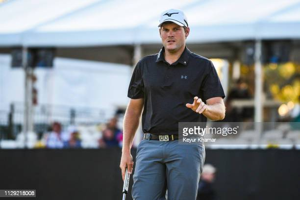 Adam Schenk waves to fans after making a birdie putt on the 17th hole during the first round of the Arnold Palmer Invitational presented by...