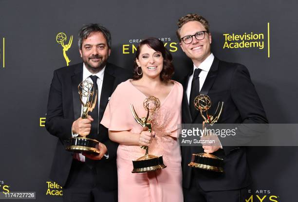 Adam Schlesinger Rachel Bloom and Jack Dolgen pose with the Outstanding Original Music and Lyrics Award for 'Crazy ExGirlfriend' in the press room...