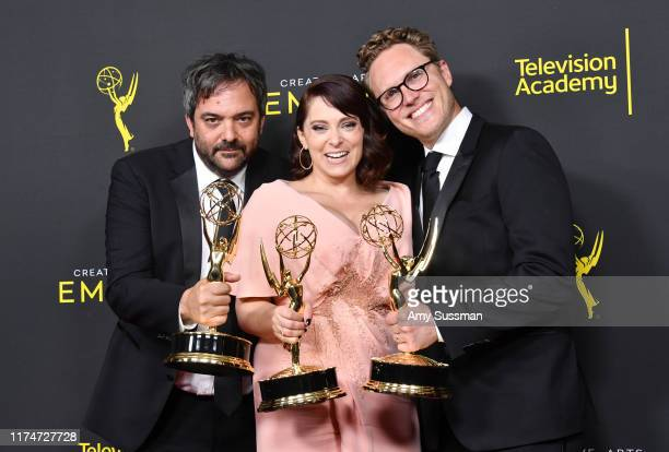 Adam Schlesinger, Rachel Bloom and Jack Dolgen pose with the Outstanding Original Music and Lyrics Award for 'Crazy Ex-Girlfriend' in the press room...