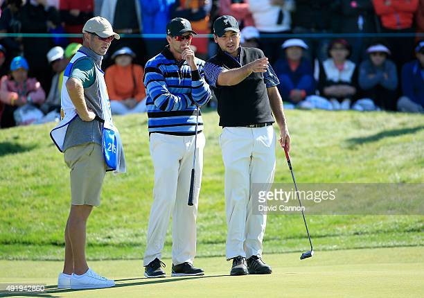 Adam Scott and Jason Day of Australia and the International team on the 13th hole in their match against Phil Mickelson and Zach Johnson of the...