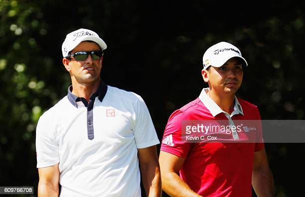 Adam Scott and Jason Day of Australia wait together on the second tee during the first round of the TOUR Championship By CocaCola at East Lake Golf...
