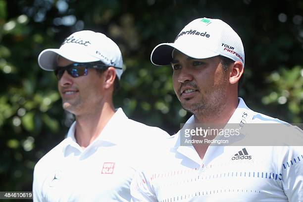 Adam Scott and Jason Day of Australia walk off the second tee during the final round of the 2014 Masters Tournament at Augusta National Golf Club on...