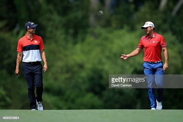 Adam Scott and Jason Day of Australia walk up the fifth fairway during the third round of the 2015 Masters Tournament at Augusta National Golf Club...