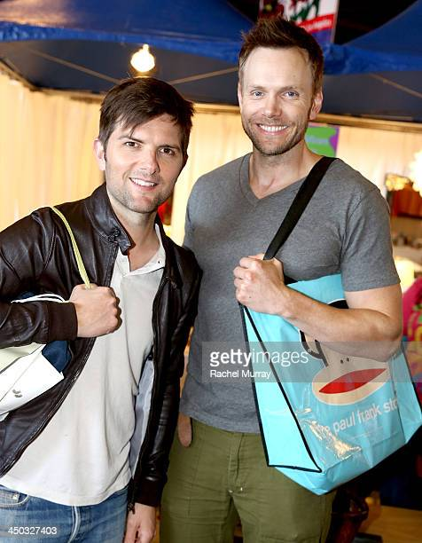 Adam Scott and Joel McHale hang out at the Paul Frank booth during the PS Arts 2013 'Express Yourself' event in Barker Hangar on November 17 2013 in...