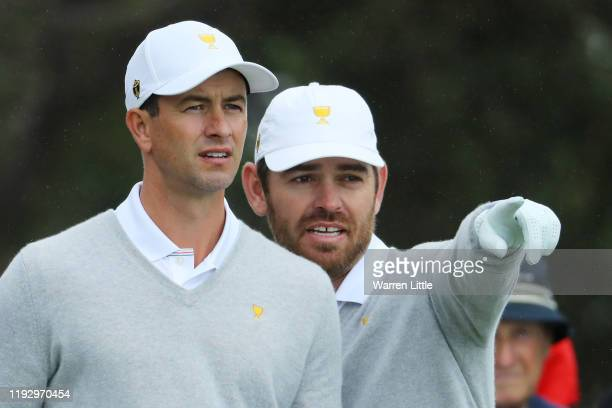 Adam Scott and Louis Oosthuizen of the International team talk as they practice ahead of the 2019 Presidents Cup at the Royal Melbourne Golf Course...