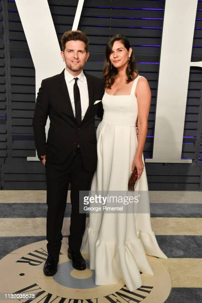 Adam Scott and Naomi Scott attend the 2019 Vanity Fair Oscar Party hosted by Radhika Jones at Wallis Annenberg Center for the Performing Arts on...