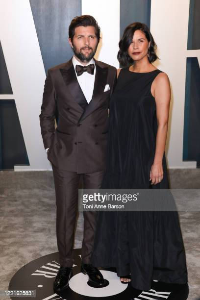 Adam Scott and Naomi Scott attend the 2020 Vanity Fair Oscar Party at Wallis Annenberg Center for the Performing Arts on February 09, 2020 in Beverly...