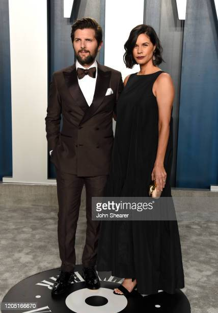Adam Scott and Naomi Scott attend the 2020 Vanity Fair Oscar Party hosted by Radhika Jones at Wallis Annenberg Center for the Performing Arts on...