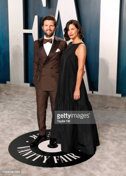 Adam Scott and Naomi Scott attend the Vanity Fair Oscar Party at Wallis Annenberg Center for the Performing Arts on February 09, 2020 in Beverly...